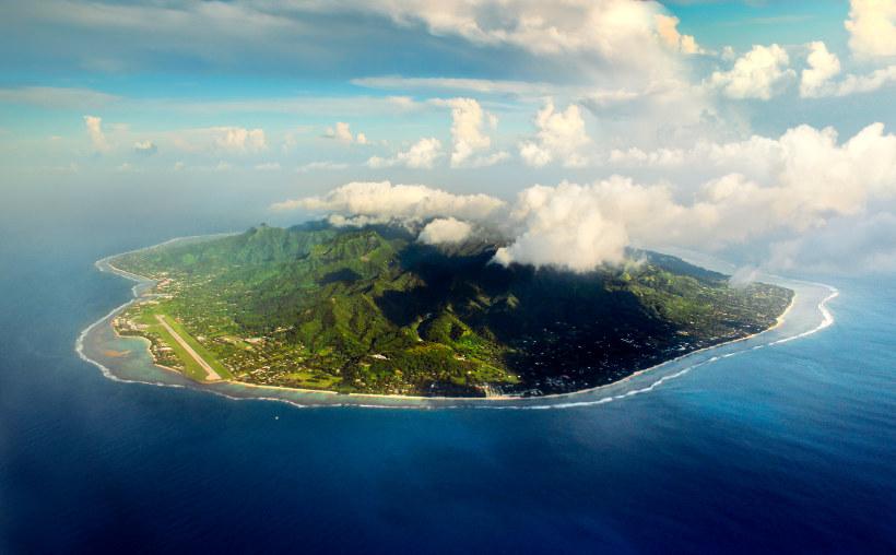 Travel Associates rarotonga island from above with cloud on top