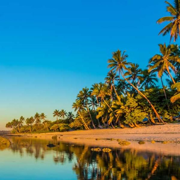 Two people standing on the beach, Fiji
